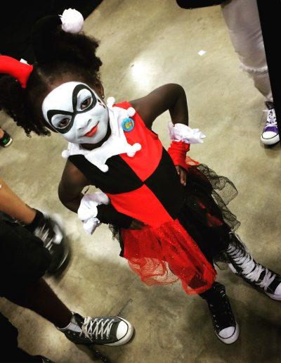 Cute girl dressed as Harley Quinn