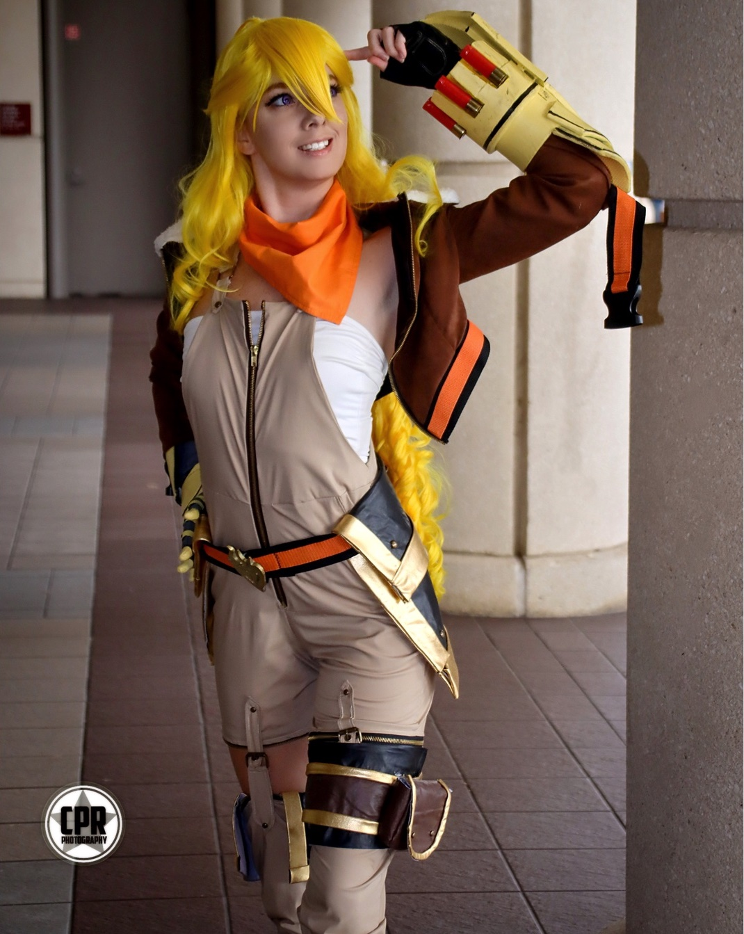 Full photo of Christina in the Yang costume in front of some columns