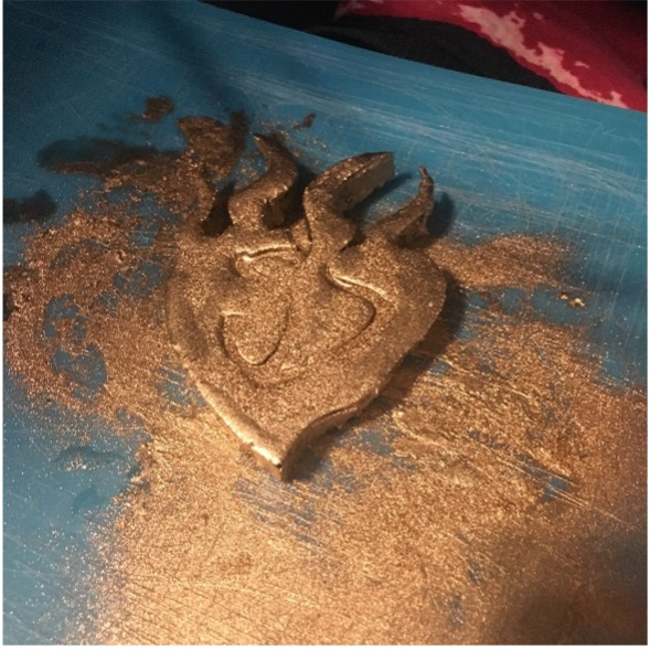 Brass powder covered foam buckle