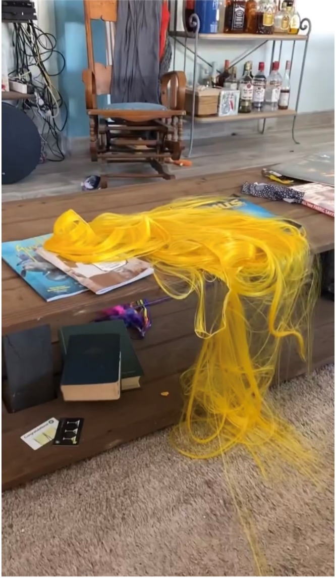 Wefts waiting to be added to the wig on the coffee table